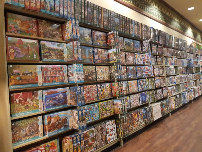 Bolen Books puzzle wall with high quality brands like Cobble Hill and Ravensburger .